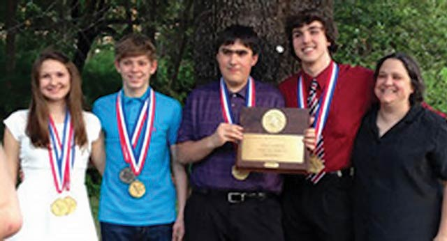 The Latexo High School UIL Math Team won its third consecutive State UIL Championship last week.  Pictured are Ashley Rothrock, first place individual; Charles Rothrock, second place individual; Byron Williams, seventh place individual; Jace Skalicky, third place individual; and Coach Audrey Cravens.  Williams is holding the team's State UIL Champion plaque. m(Latexo ISD Photo)
