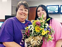 Dispatch Supervisor Susie Hammond is pictured with Dispatcher Carly Jenkins during Telecommunicators Appreciation Week.  Jenkins also is an officer with the Grapeland Police Department.