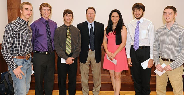 SFA student John Burns (right) and peers receive the Albert Ruel Parrott Memorial Scholarship from Dr. Steven Bullard (middle), dean of the Arthur Temple College of Forestry and Agriculture, at the 2014 Forestry and Environmental Science Awards Convocation. Burns also received the Bone Hill Foundation Field Station Scholarship during the ceremony. (SFASU Photo)