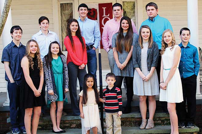 Photo by Lynda Jones The 2016 Royal Lovefest Court made its debut at the historic Collins house in Lovelady on Wednesday, Jan. 27.  Pictured are Eighth Grade Princess Hannah York and Escort Kent Thatcher, Freshman Princess Morgan LaRue and Escort Logan Lowery; Sophomore Princess Miranda Moore and Escort Ethan Tullos; Junior Princess Allison Hay and Escort Daniel Cook; Senior Princess Hannah Gresham and Escort Cole Cimrhanzl, and Seventh Grade Princess Kyra Rogers and Escort Caleb Larkin. Flower Girl is Ryan Corley and Crown Bearer is Jayden McCullough.  The coronation ceremony will be Thursday, Feb. 11 in the Lovelady High School gym. (Lynda Jones Photo)