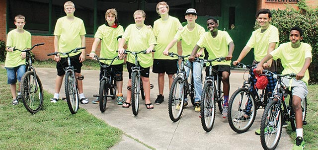Nine boys at the Serenity Place, Inc., residential treatment facility in Crockett prepare to go for a  spin on bicycles bought for their use by facility owners Chris and Wanda Brown. (Photo by Alton Porter/HCCourier)