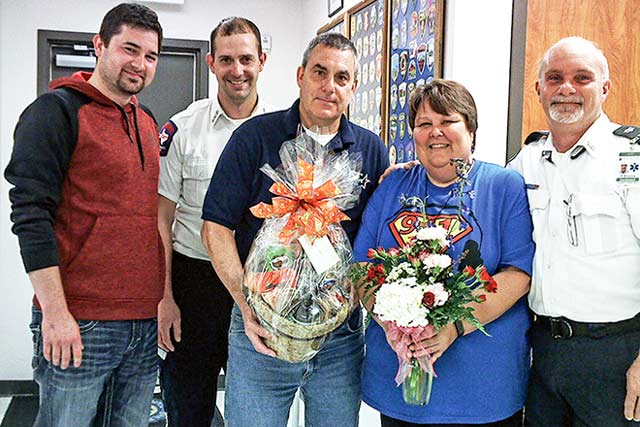 Courtesy Photo Pictured are Dispatch Supervisor Susie Hammond and Dispatcher Daniel Williams along with Chief of Operations for Houston County EMS Bradley Baucom, Lt. Eric Adams and Bart Mallett with gifts received in appreciation of the work Houston County dispatchers do.