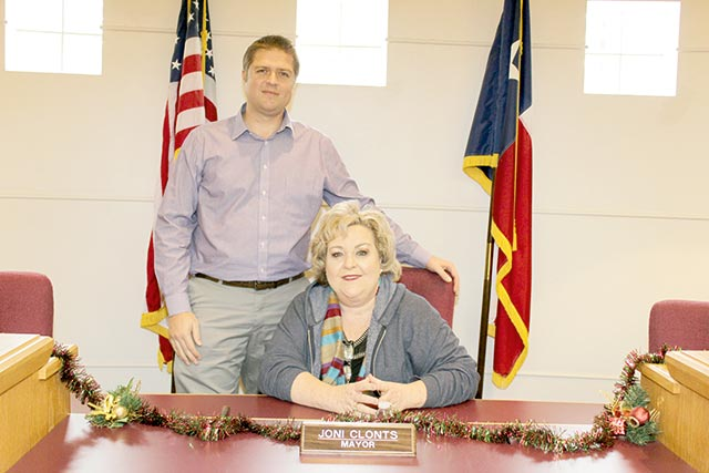 Mayor Joni Clonts, sitting, and City Administrator John Angerstein take a break to smile for a photo as they discuss a variety of projects that are destined to result in good news in 2018. (Alton Porter | HCC)