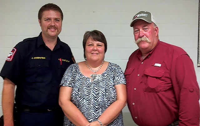 Crockett Fire Chief John Angerstein and Austonio Fire Chief Russell Jenkins are pictured with HCSO Dispatch Supervisor at the Houston County Emergency Management meeting on July 31. (Photo by Sherry Driskell)