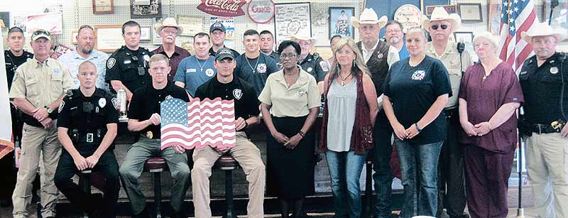 County and city law enforcement personnel, firefighters, military personnel and other first responders, along with county and city officials – including County Judge Erin Ford and Crockett Mayor Robert Meadows – joined with friends and supportive citizens at The Moosehead Café on Friday, Sept. 9, to remember American heroes and others who perished in the national tragedy on Sept. 11, 2001. (Judy Scott/Crockett Area Chamber of Commerce Photo)