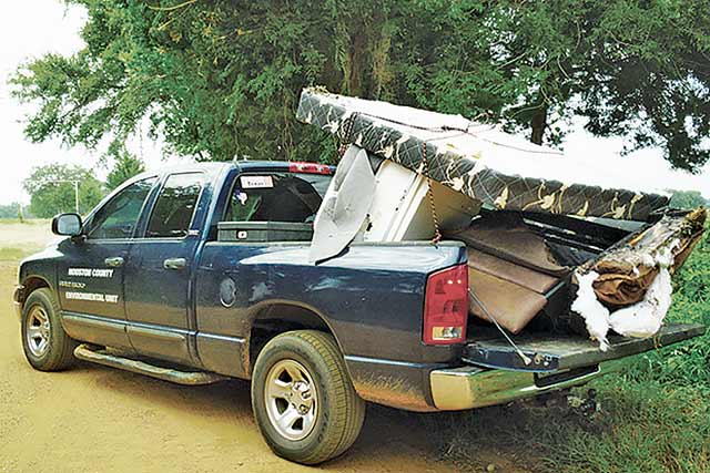 This is one of many loads of illegally dumped trash Houston County/City of Crockett Environmental Control Officer Ashlie Perry and community service workers picked up from Houston County and City of Crockett roads in July. (Courtesy Photo)