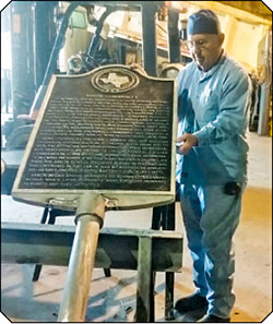 George Young, shown above, displays his expert welding craftsmanship. Young repaired two damaged Houston County Historical Markers for the HCHC at little cost.